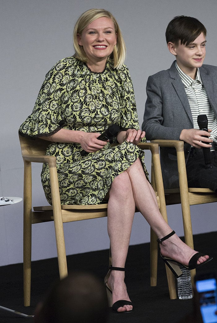 Kirsten Dunst wears a lime-green-and-black dress during an Apple Store event