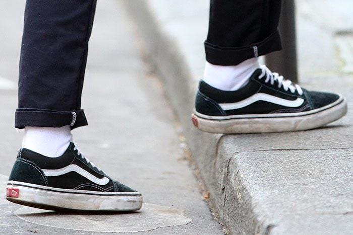 Kristen Stewart's dirty and beat-up black Vans 'Old Skool' sneakers