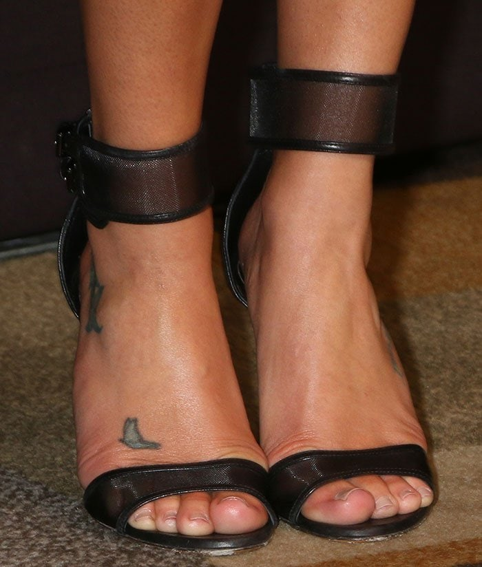 Lea Michele's feet and foot tattoo in black Casadei sandals
