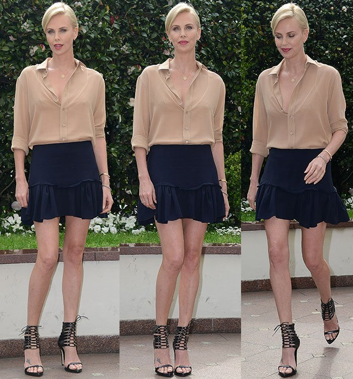Charlize Theron flaunted her hot legs in a Saint Laurent top and a Chloe skirt
