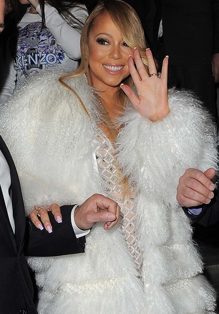 Mariah Carey smiles for the cameras despite being late to herO2 gig in London on March 23, 2016