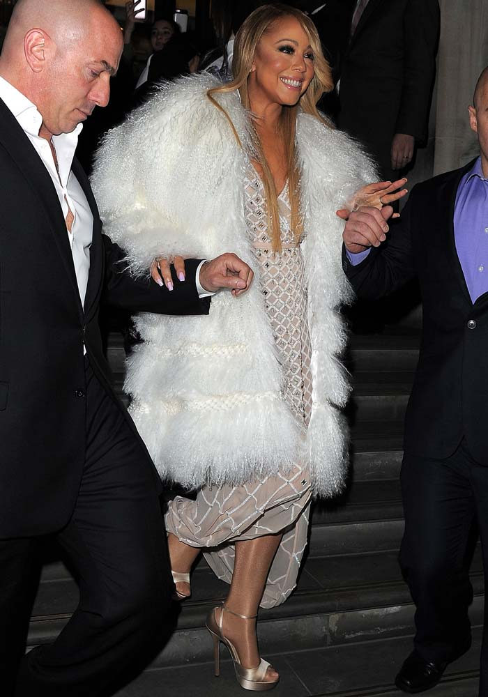e96460c4d08 Mariah Carey wearing Temperley London s Alika dress underneath a gigantic  white fur coat