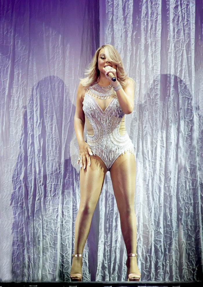 Mariah Carey performs in Scotland while wearing a silver bodysuit