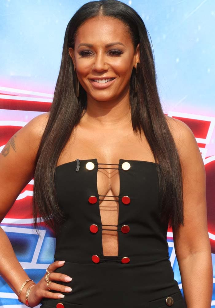 Mel B flaunts her boobs in a cleavage-baring strapless sheath dress