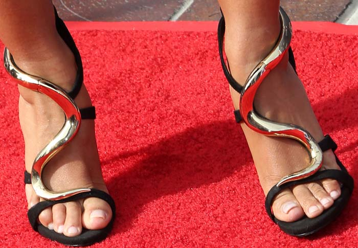 Mel B shows off her feet in iconic gold-plated suede sandals by Giuseppe Zanotti
