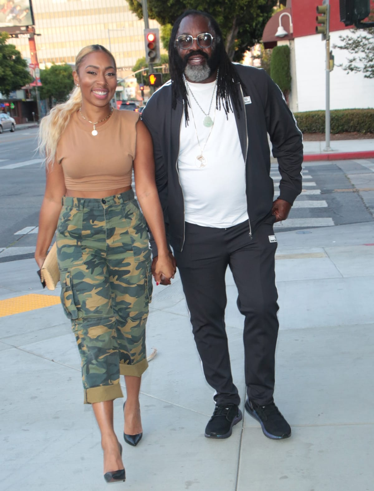 Niki McElroy and Kazembe Ajamu Coleman holding hands in Los Angeles
