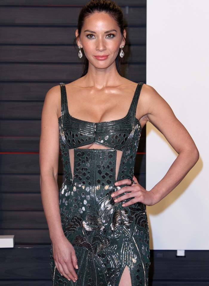 Olivia Munn shows off a hint of underboob thanks to the cutouts in her J. Mendel dress