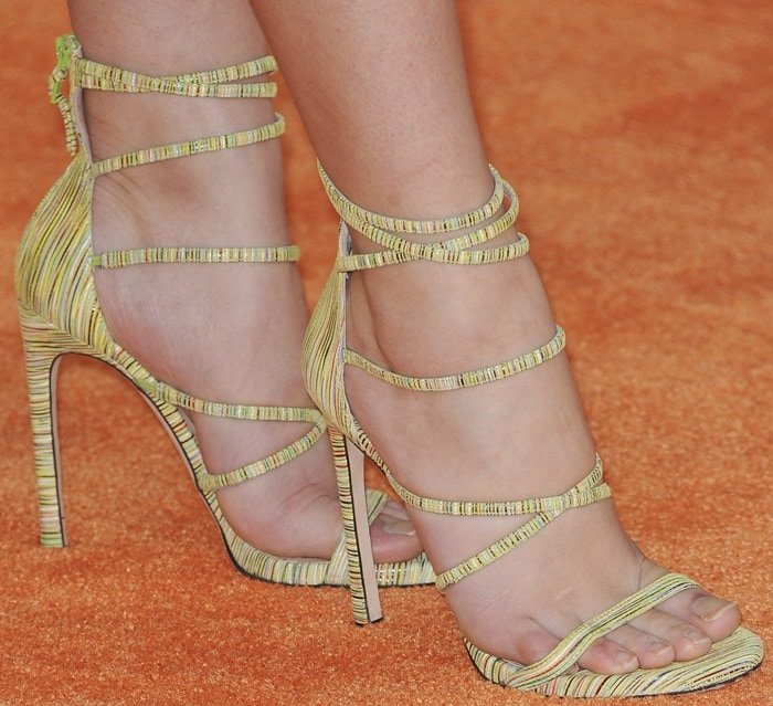 Paris Berelc shows off her feet in strappy green sandals by Stuart Weitzman