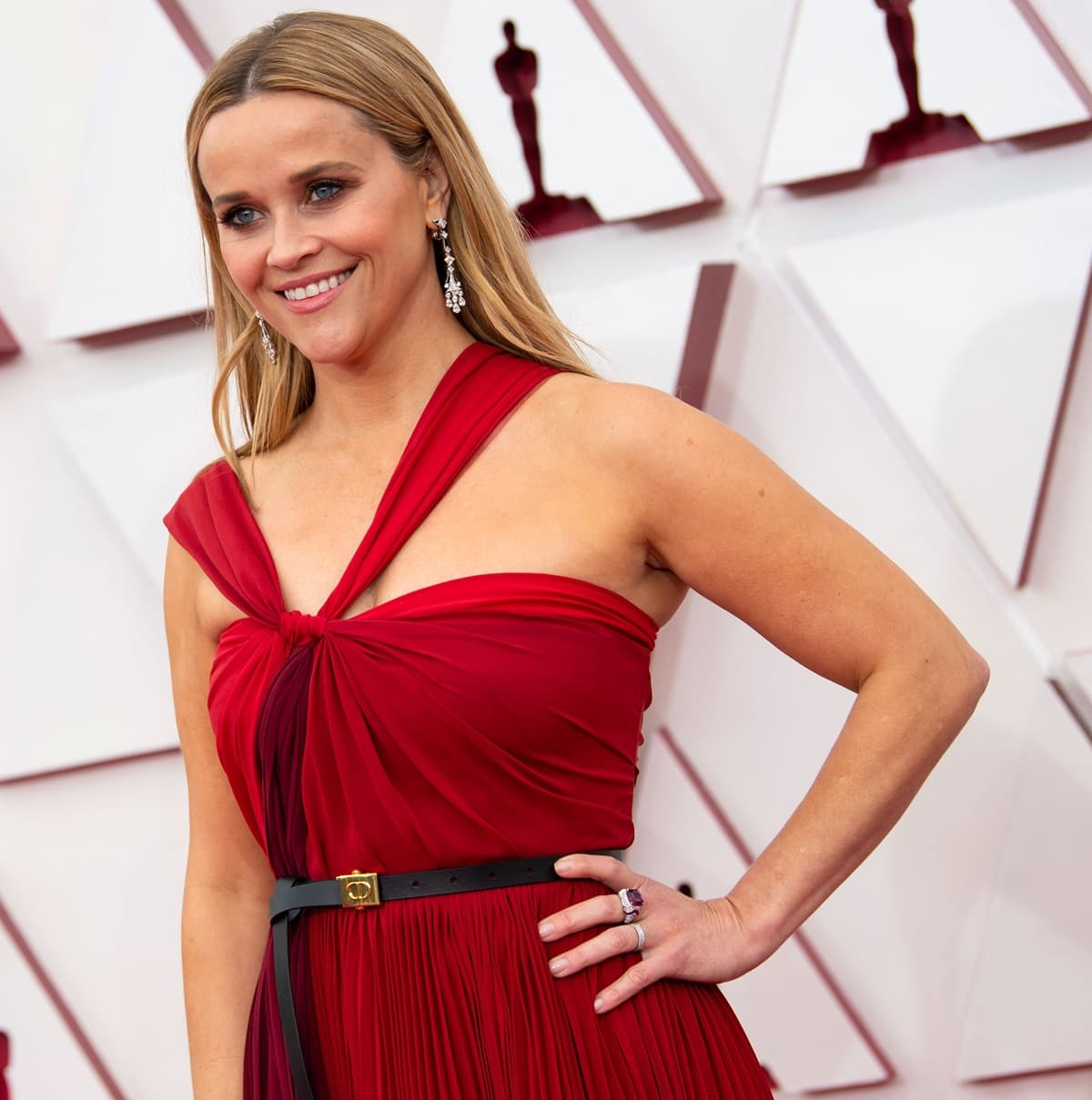 Reese Witherspoon in a deep red Christian Dior halter-neck dress at the awards show