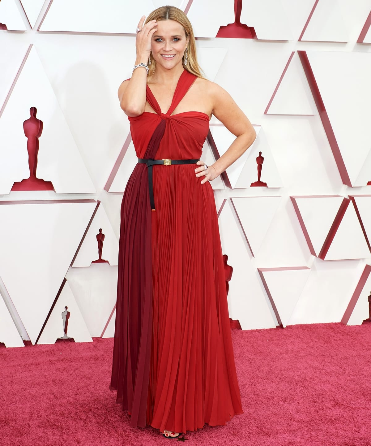 Reese Witherspoon in a red Dior dress and Bvlgari jewelry at the 2021 Academy Awards