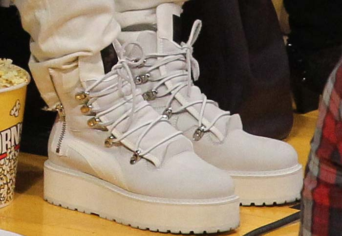 Rihanna wears a pair of Fenty x Puma boots court-side to an NBA game