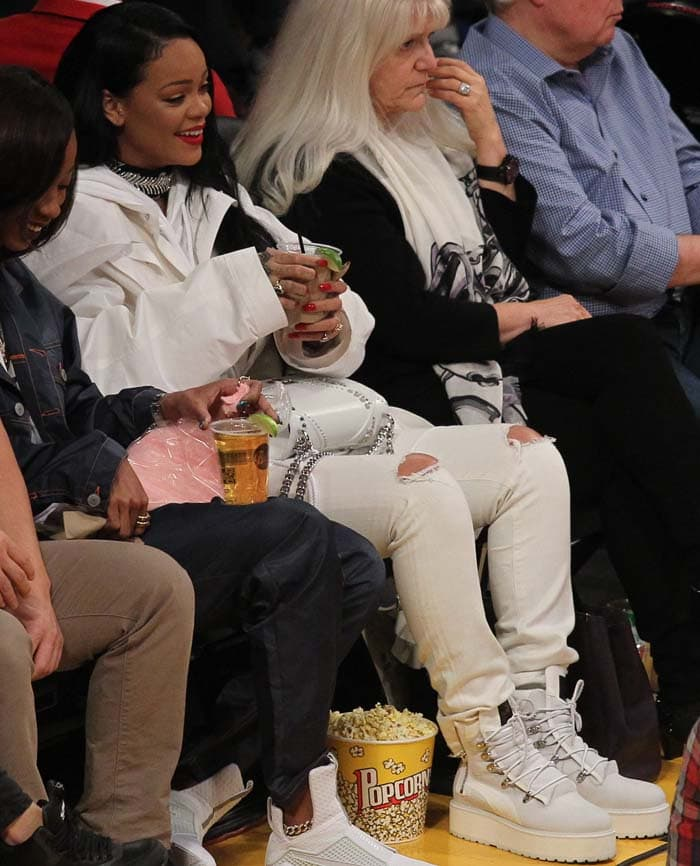 Rihanna wears an all-white ensemble at a recent LA Lakers game