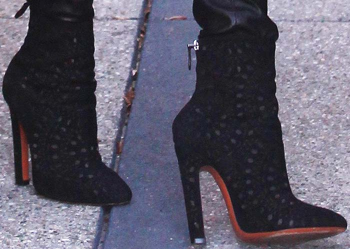 Rosie Huntington-Whiteley slips into her Alaïa boots to get things done for the day