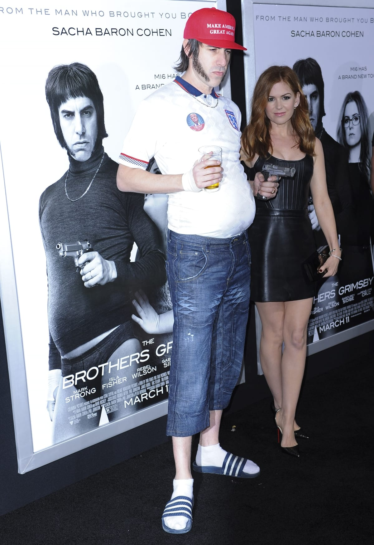 """Producer/writer/actor Sacha Baron Cohen (L) and his wife Isla Fisher attend the premiere of Columbia Pictures and Village Roadshow Pictures """"The Brothers Grimsby"""""""