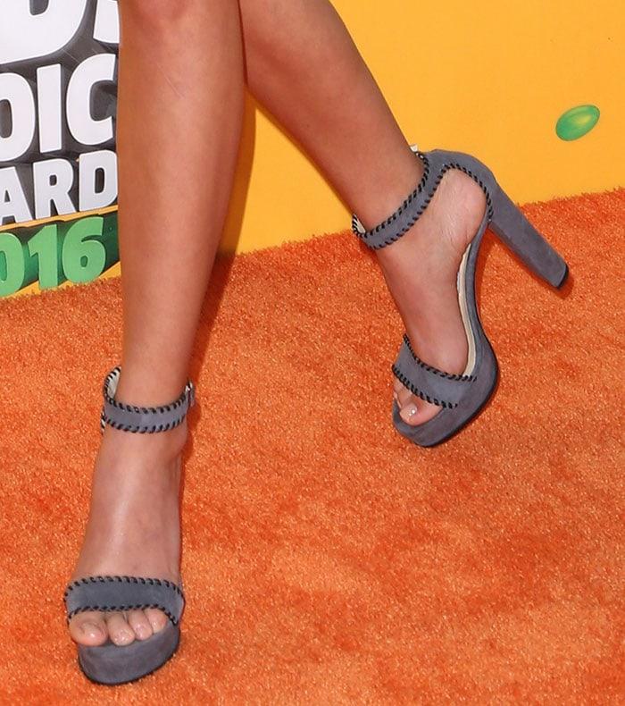 Sarah Hyland's feet in gray suede Jimmy Choo heels