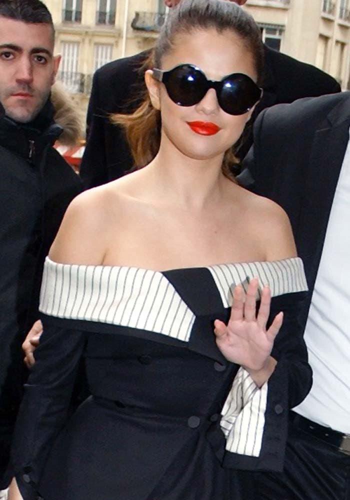 Selena Gomez wears her hair back as she arrives at NRJ Radio in Paris