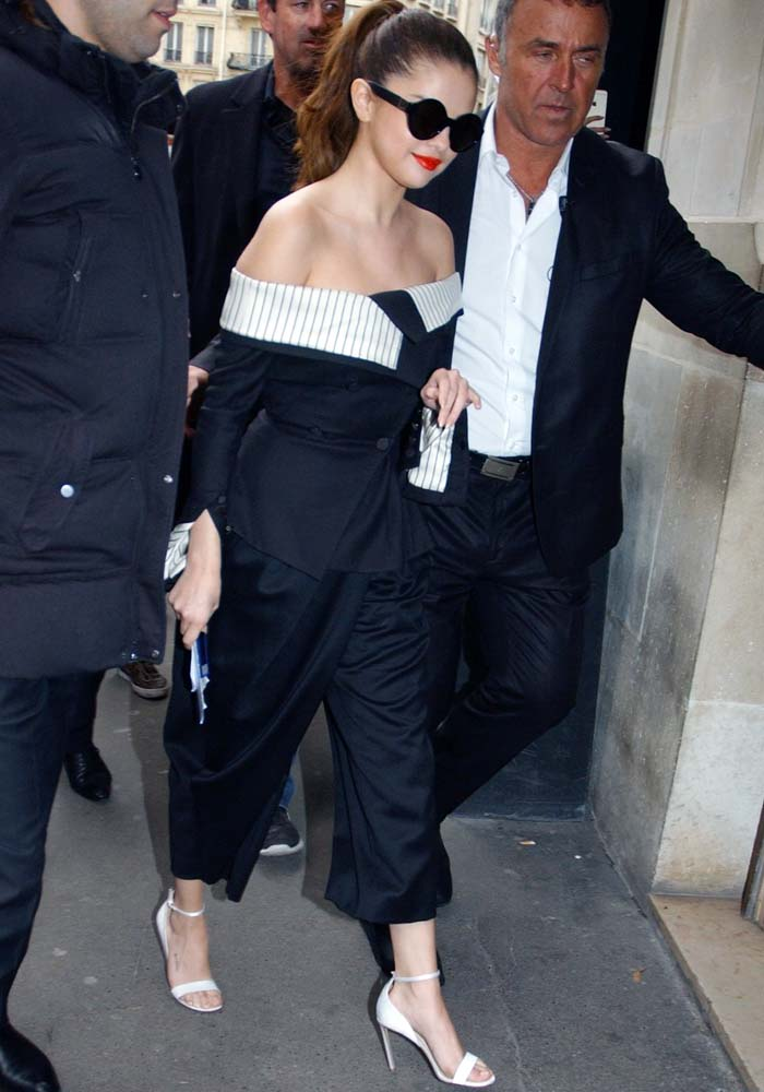 Selena Gomez wears a Monse ensemble and a pair of dark sunglasses while out in Paris