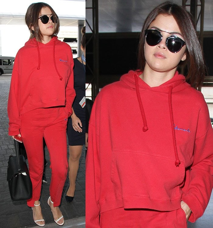 Selena Gomez in red sweats arrives at Los Angeles International Airport