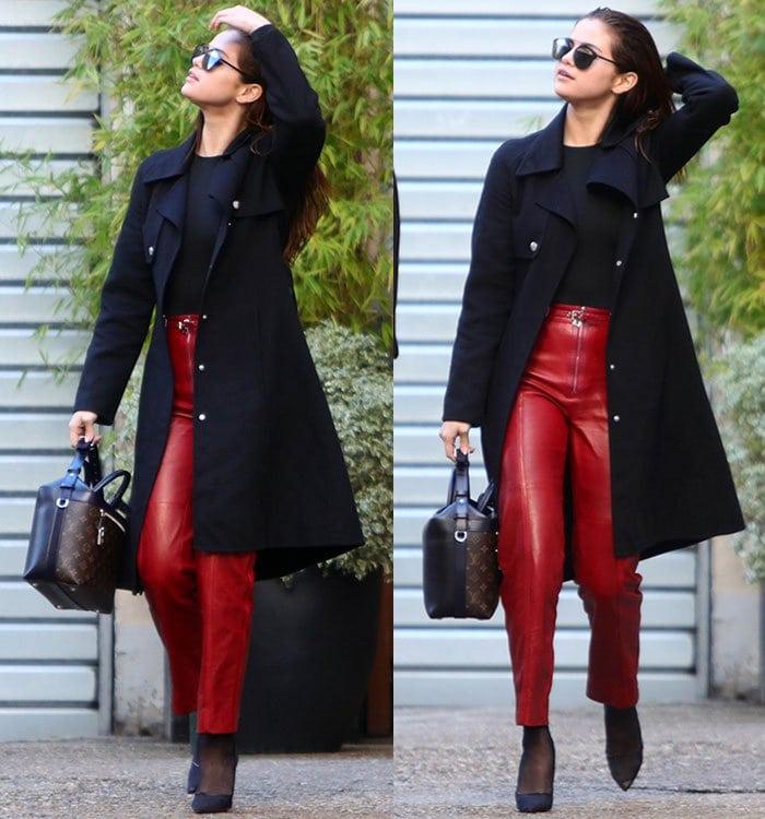 Selena Gomez wears a pair of red Louis Vuitton pants