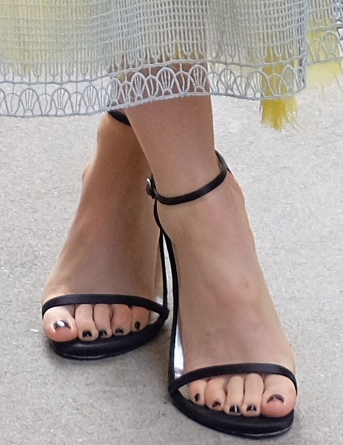 Sophia Bush's feet in black satin Stuart Weitzman sandals