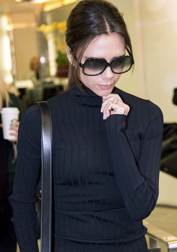 Victoria Beckham arrives at her store opening event in Hong Kong