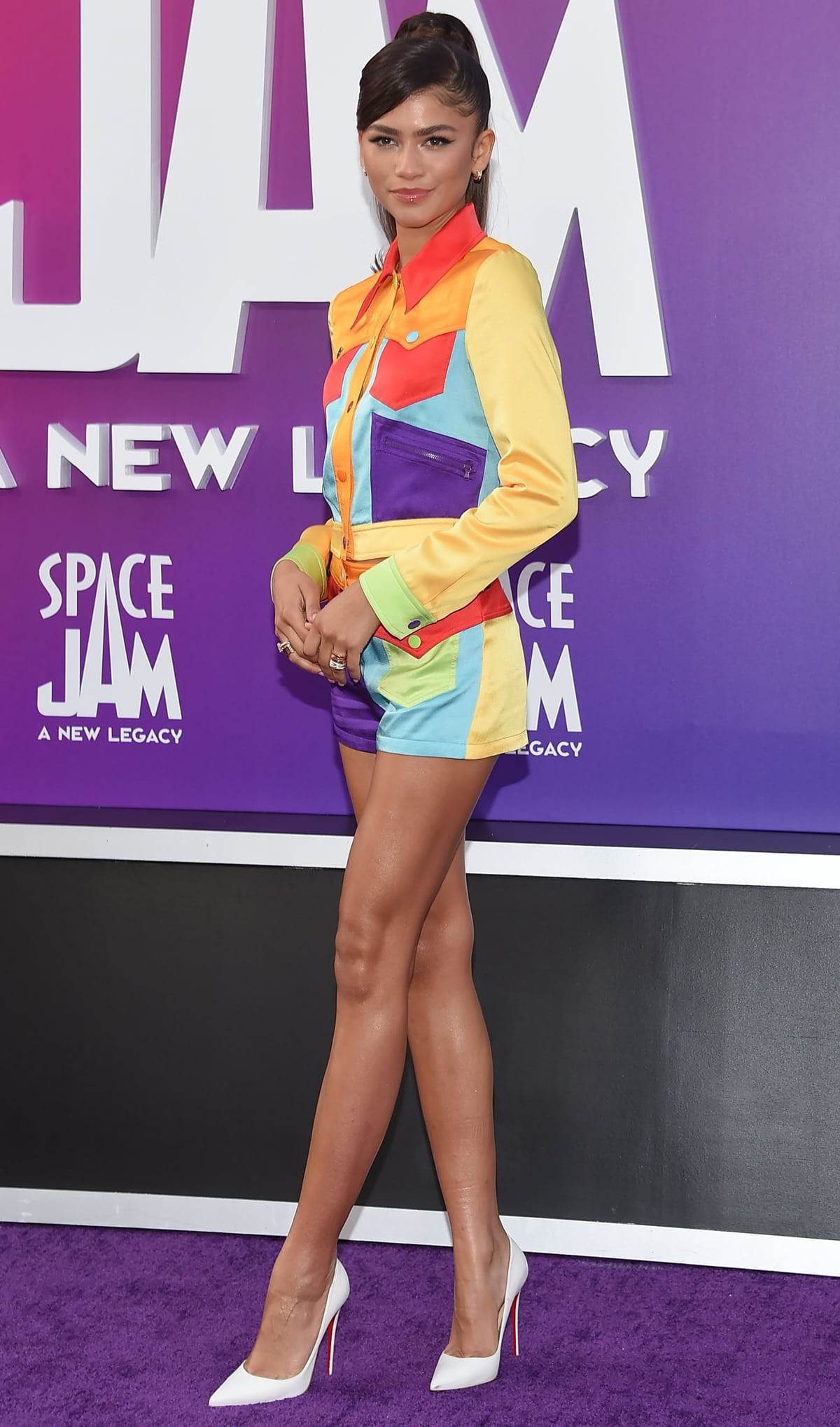 Zendaya flaunts her long legs in Christian Louboutin pumps paired with a colorful Moschino outfit