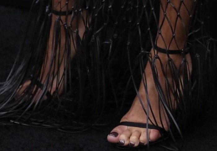 Zoe Kravitz's feet in black Stuart Weitzman heels