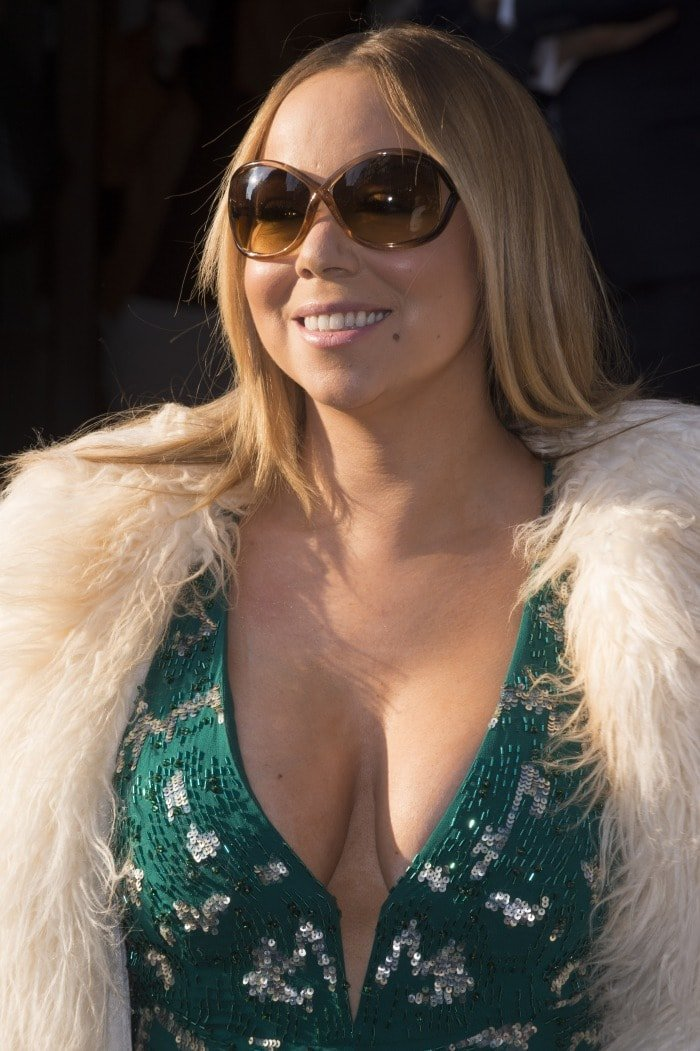 Mariah Carey shows off her cleavage in a sequined Roberto Cavalli dress