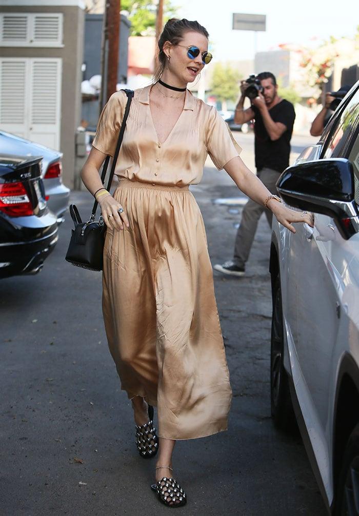 Behati-Prinsloo-shopping-gold-silky-maxi-dress