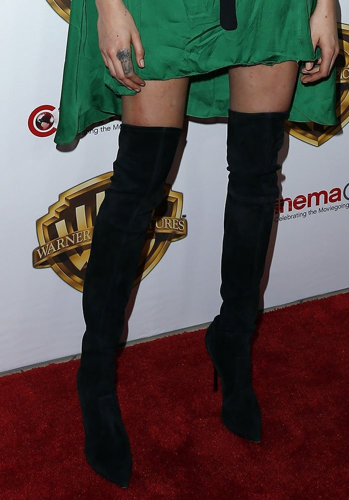 Cara Delevingne drew further attention to her legs with a pair of thigh-high boots by Casadei