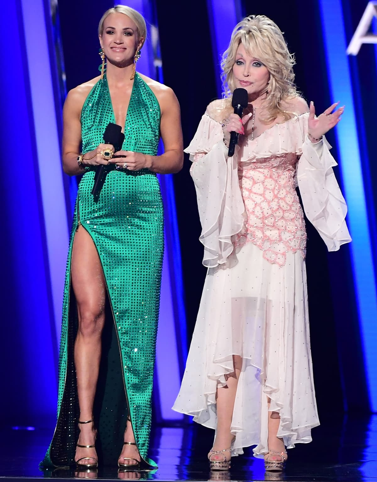 Carrie Underwood (L) and Dolly Parton speak onstage during the 53rd annual CMA Awards