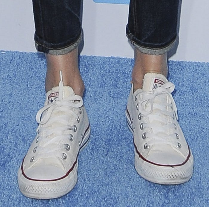 Charlize Theron in Converse Chuck Taylor All Star sneakers