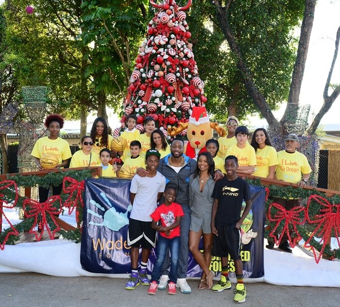 Dada Wade, Dwyane Wade, Zion Wade, Gabrielle Union, and Zaire Wade attend a fun-filled day at Santa's Enchanted Forest for Wade's World Foundation 'Under the Tree' Event