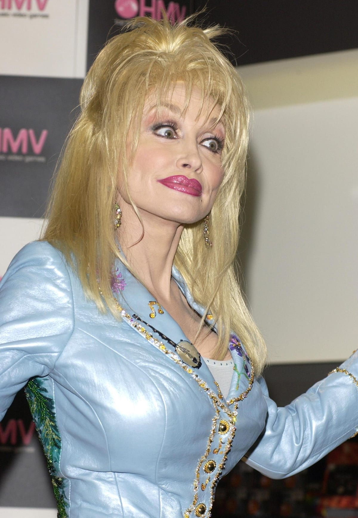 Singer Dolly Parton highlights her boobs while promoting her new album Halos and Horns