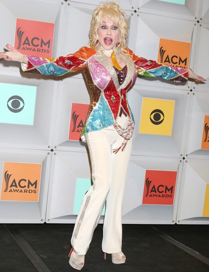 Dolly Parton in a colorful sequined jacket at the 2016 Academy of Country Music Awards
