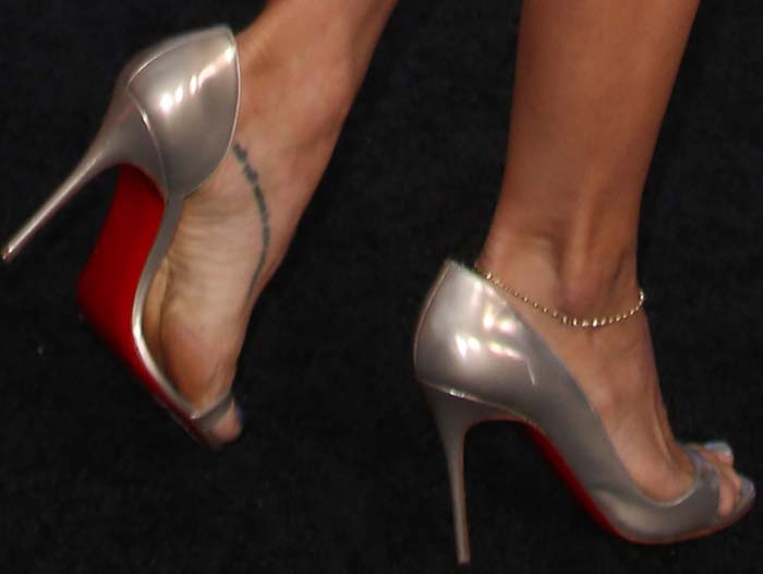 "Elsa Pataky's feet in silver patent ""Toboggan"" pumps"