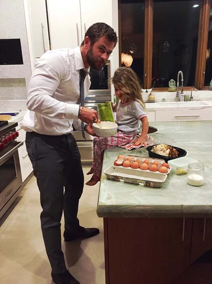 "Elsa Pataky uploads an adorable photo of her husband with their daughter, captioned, ""Papa making some late snack after premiere @thehunstman #jetlag #bestglamour #yummy #papachef #bestmoments #latrip"""