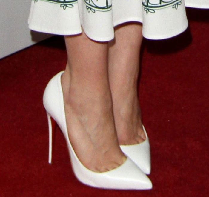 Emilia Clarke shows off her feet in Christian Louboutin pumps
