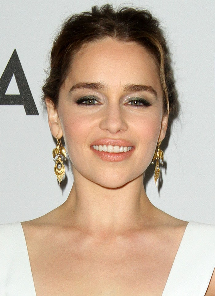 Emilia Clarke's hair was worn up in a messy but chic updo