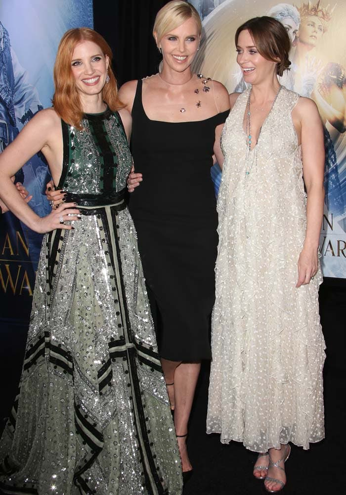 Emily Blunt giggles with her co-stars Charlize Theron and Jessica Chastain at the premiere of 'The Huntsman: Winter's War'