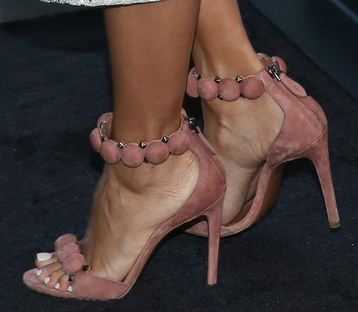 Eva Longoria wearing Alaia studded suede sandals