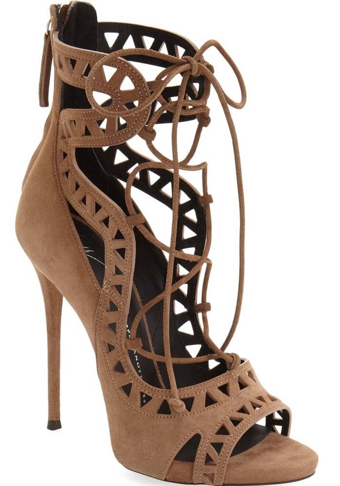 Curvaceous straps and geometric cutouts extend the eye-catching vintage appeal of an open-toe suede sandal set on a lofty stiletto heel for an extra dash of glamour