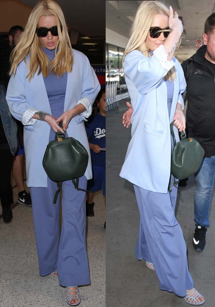 Iggy Azalea ina jumpsuit with a high neck and wide leg pants