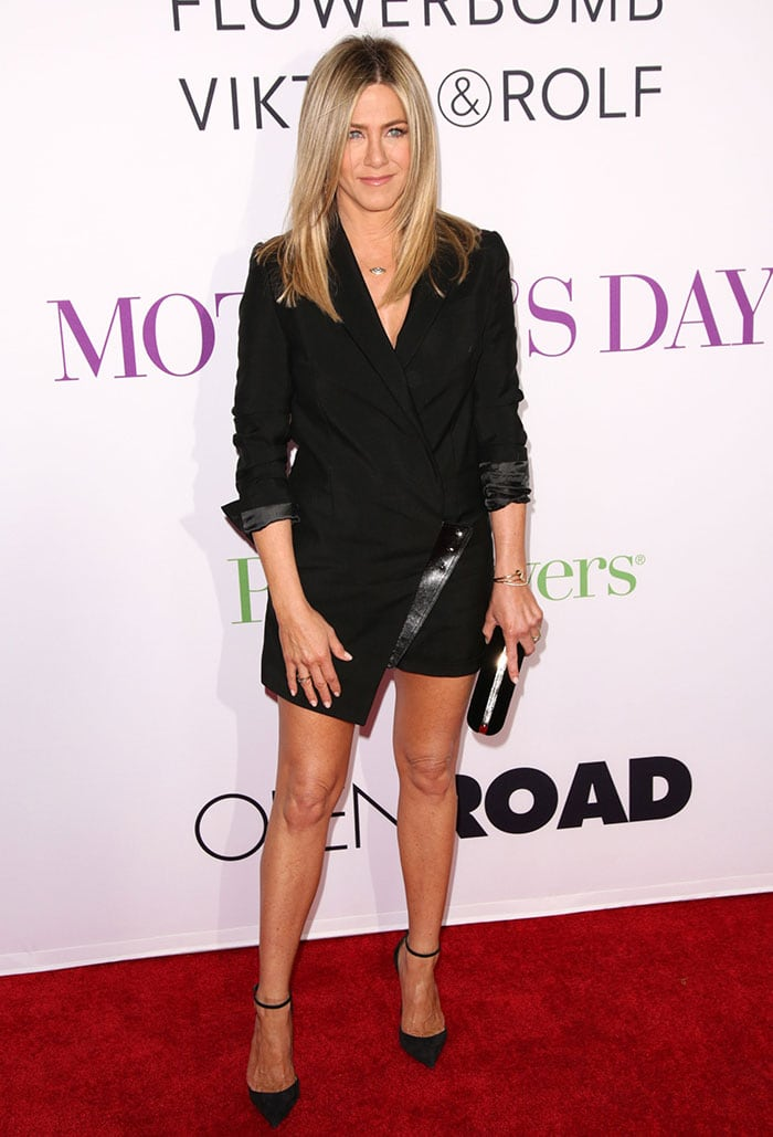 Jennifer Aniston showcasing her legs in a black tuxedo-style mini dress from Anthony Vaccarello's Spring 2016 collection