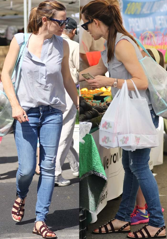 Jennifer Garner in a sleeveless button-down top casually tucked into a pair of denim jeans
