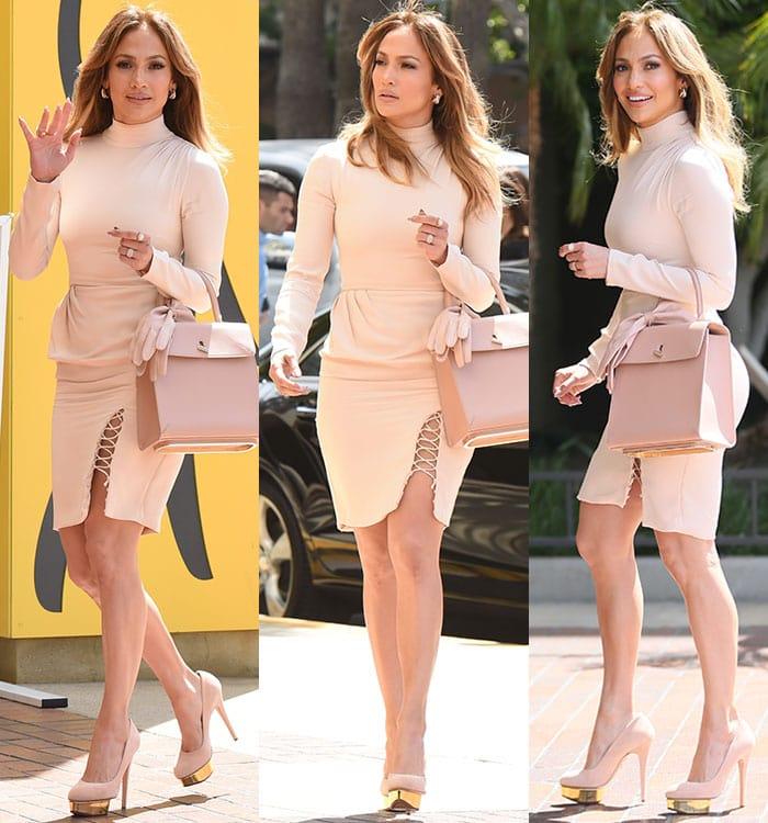 Jennifer Lopez in a form-fitting blush dress