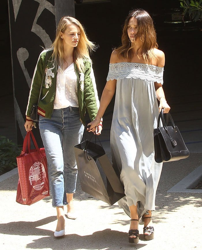 Jessica Alba wearing a chic off-the-shoulder maxi dress by Self Portrait