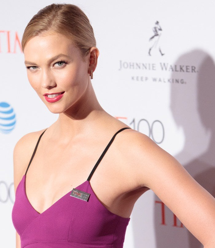Karlie Kloss wearing a purple spaghetti strapped maxi dress from Victoria Beckham