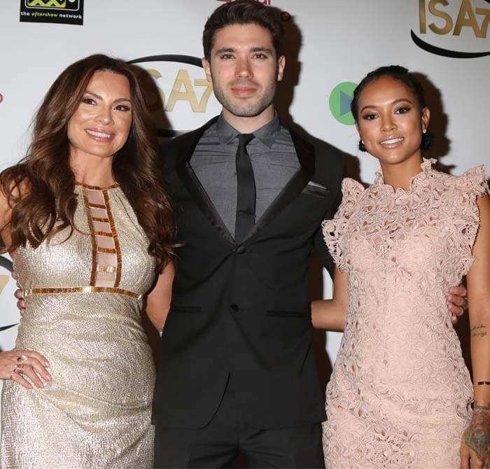 Karrueche Tran poses on the red carpet with fellow actors Lilly Melgar and Kristos Andrews