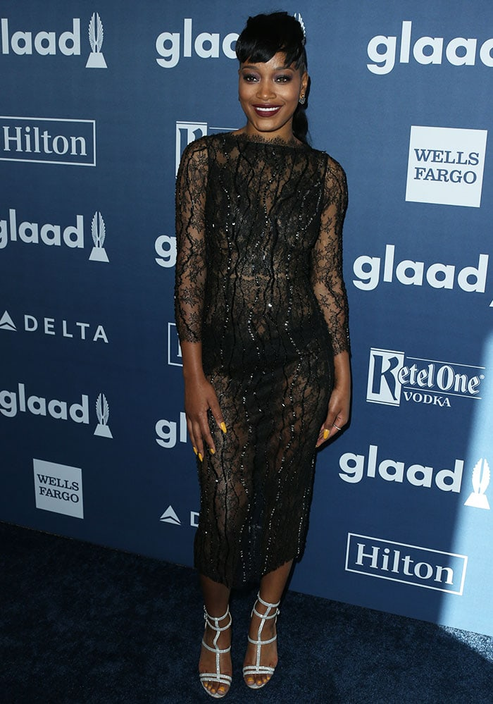 Keke Palmer flashes her panties in a see-through black lace dress